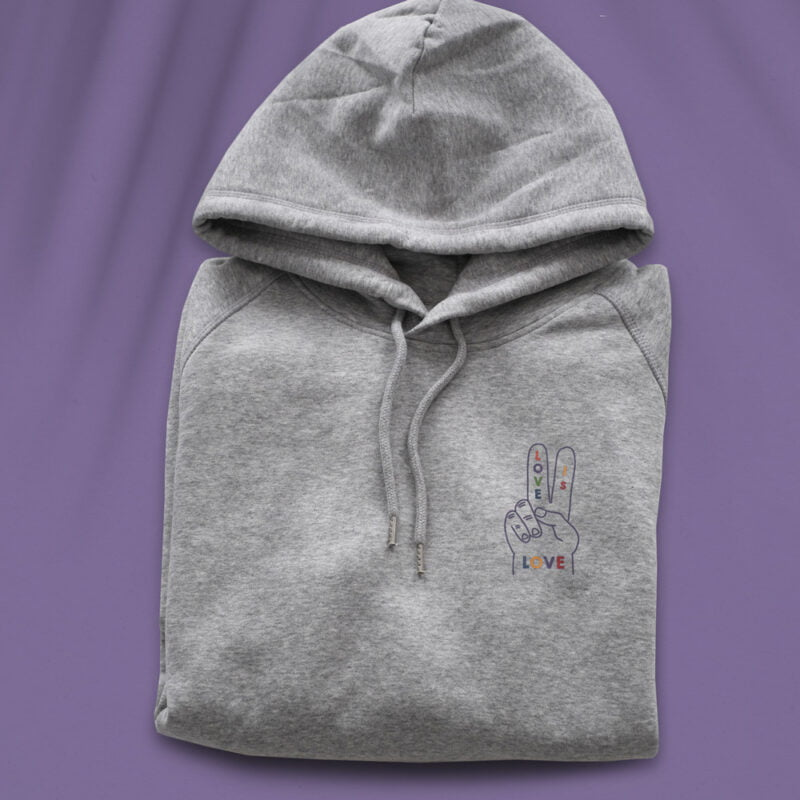 """Hoodie with a peace and love design embroidered on the chest. The message """"Love is love"""" is written in rainbow colors on a hand making the peace sign. Hoodies - LGBTQ+ Gay Pride Apparel - loveislove hoodie color 1"""