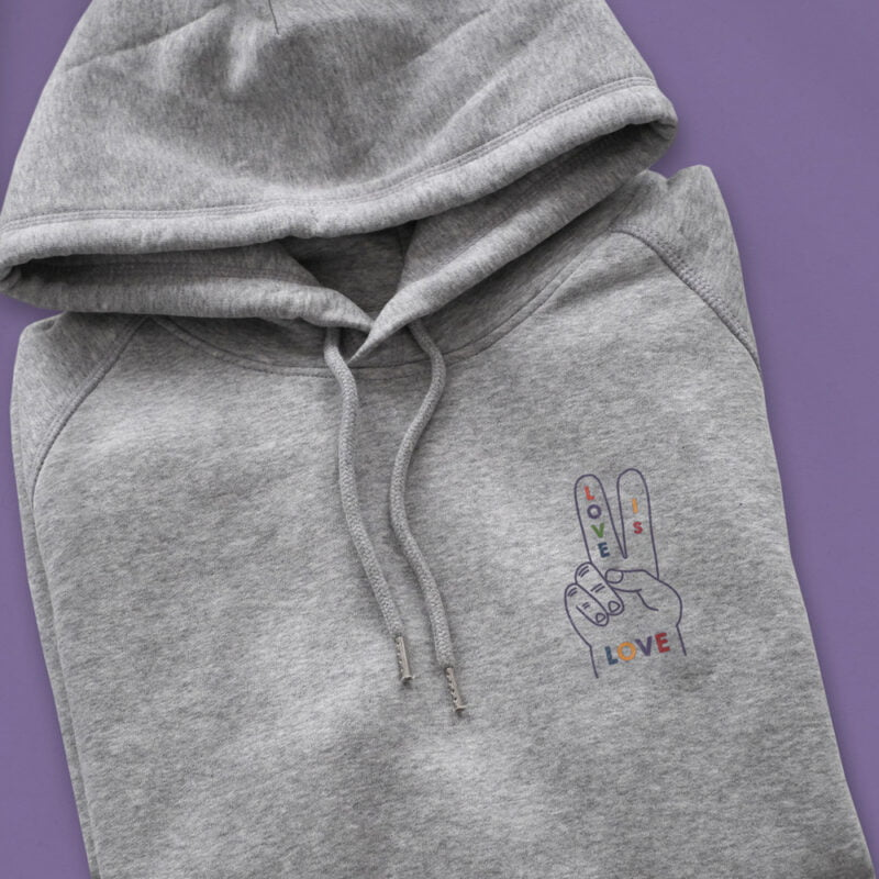 """Hoodie with a peace and love design embroidered on the chest. The message """"Love is love"""" is written in rainbow colors on a hand making the peace sign. Hoodies - LGBTQ+ Gay Pride Apparel - loveislove hoodie color 2"""