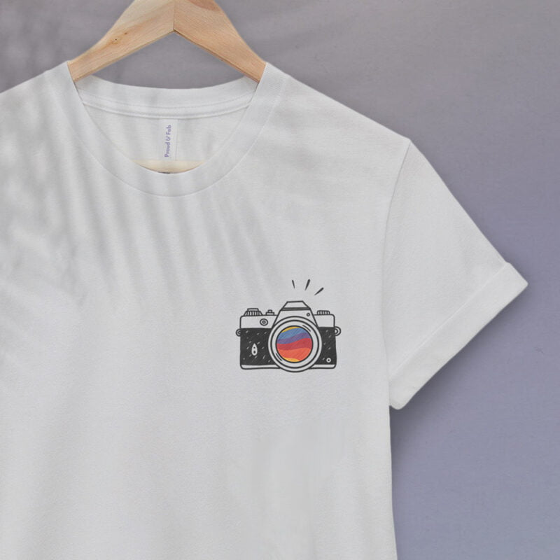 T-shirt with a vintage camera embroidered on the left chest. A rainbow is visible through the lens. T-shirts - LGBTQ+ Gay Pride Apparel - camera tshirt 2