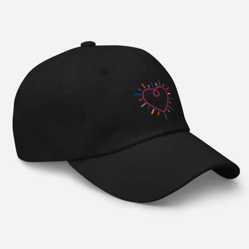 Dad hat with a heart embroidered. The heart is made from the 6 colors of the LGBT flag. Cap - LGBTQ+ Gay Pride Apparel - classic dad hat black right front 60a2bc34c2145