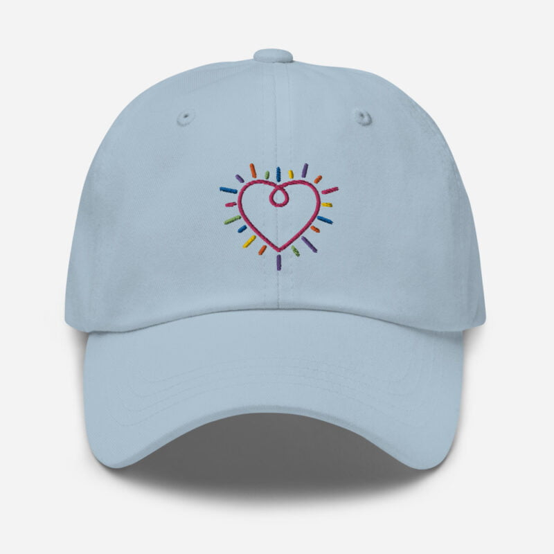 Dad hat with a heart embroidered. The heart is made from the 6 colors of the LGBT flag. Cap - LGBTQ+ Gay Pride Apparel - classic dad hat light blue front 60a2bc34c25de