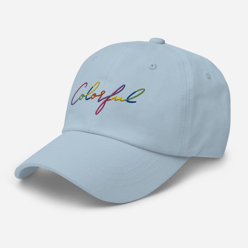 Dad hat with the word Colorful handwritten on it. Cap - LGBTQ+ Gay Pride Apparel - classic dad hat light blue left front 60a2ba00a7fd9