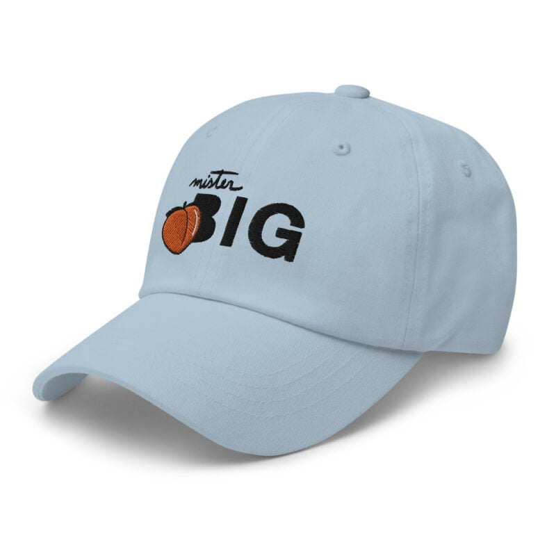 """Cap made for the members of the big booty club. It represents an embroidery of a peach and the text """"Mister BIG"""". Cap - LGBTQ+ Gay Pride Apparel - classic dad hat light blue left front 60af53601637f"""