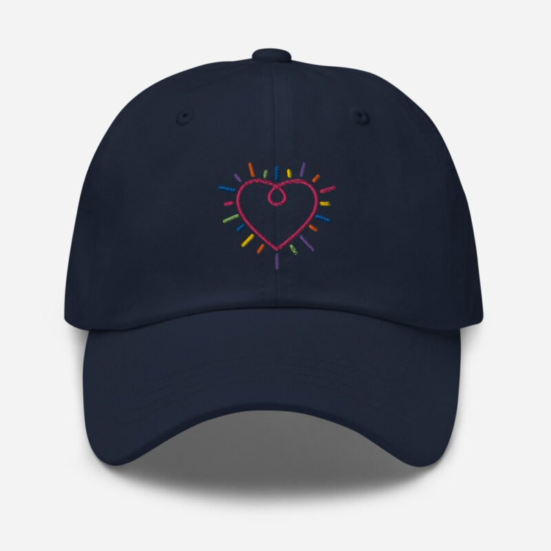 Dad hat with a heart embroidered. The heart is made from the 6 colors of the LGBT flag. Cap - LGBTQ+ Gay Pride Apparel - classic dad hat navy front 60a2bc34c22fb