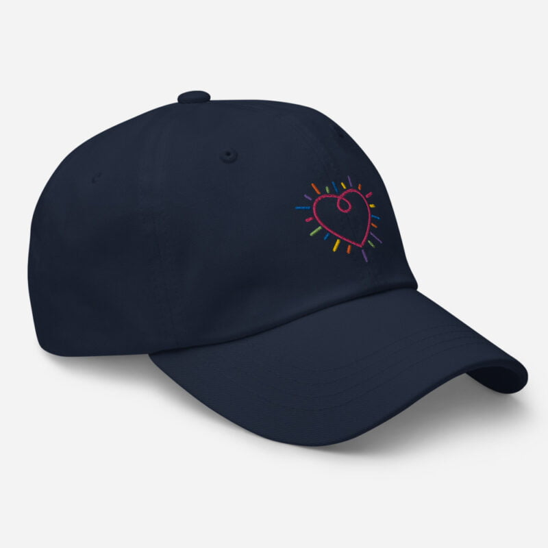 Dad hat with a heart embroidered. The heart is made from the 6 colors of the LGBT flag. Cap - LGBTQ+ Gay Pride Apparel - classic dad hat navy right front 60a2bc34c2430