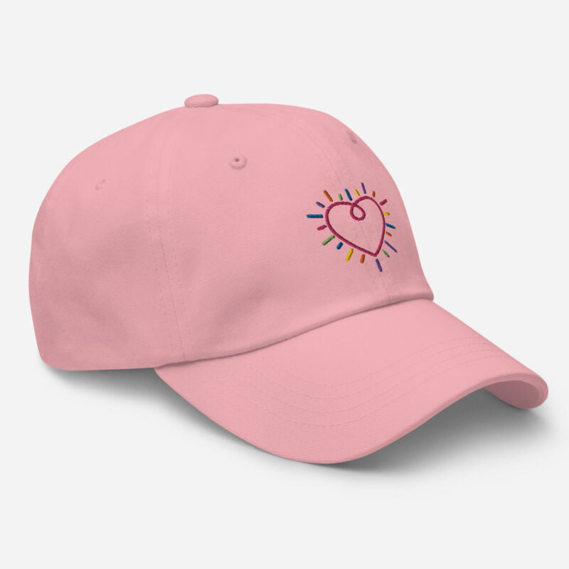 Dad hat with a heart embroidered. The heart is made from the 6 colors of the LGBT flag. Cap - LGBTQ+ Gay Pride Apparel - classic dad hat pink right front 60a2bc34c2a90