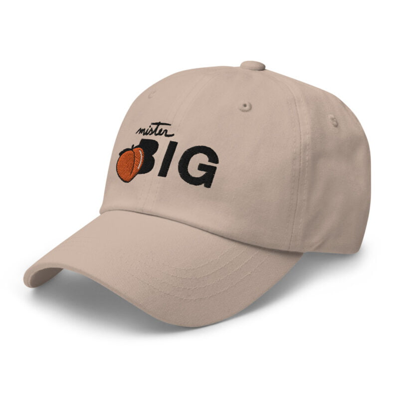 """Cap made for the members of the big booty club. It represents an embroidery of a peach and the text """"Mister BIG"""". Cap - LGBTQ+ Gay Pride Apparel - classic dad hat stone left front 60af536016913"""