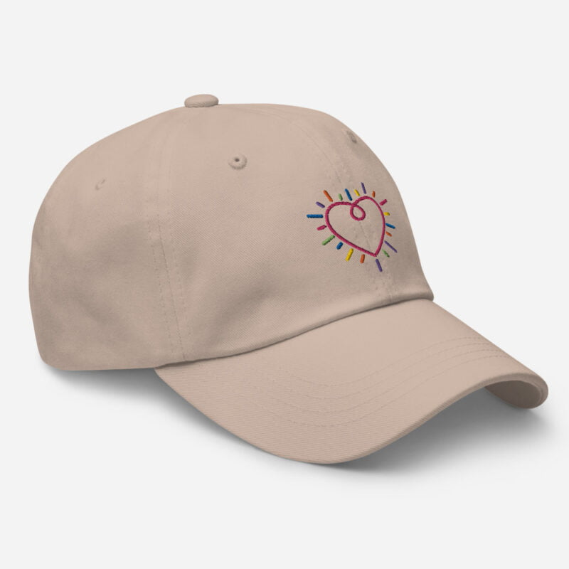 Dad hat with a heart embroidered. The heart is made from the 6 colors of the LGBT flag. Cap - LGBTQ+ Gay Pride Apparel - classic dad hat stone right front 60a2bc34c2e36