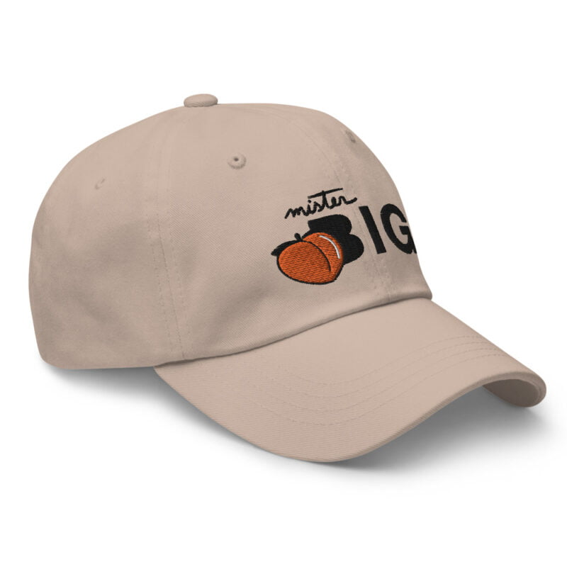 """Cap made for the members of the big booty club. It represents an embroidery of a peach and the text """"Mister BIG"""". Cap - LGBTQ+ Gay Pride Apparel - classic dad hat stone right front 60af53601685c"""
