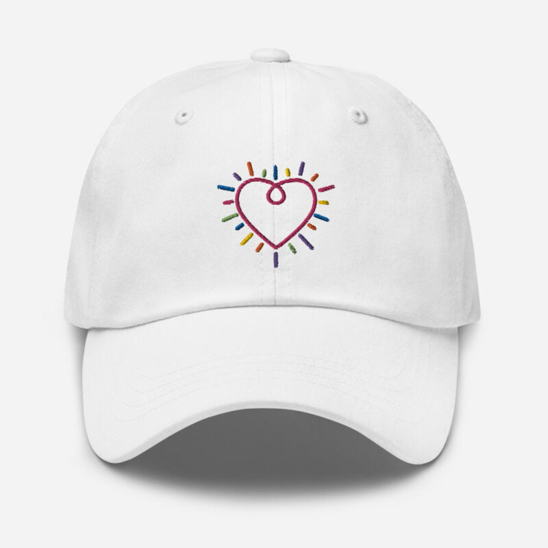 Dad hat with a heart embroidered. The heart is made from the 6 colors of the LGBT flag. Cap - LGBTQ+ Gay Pride Apparel - classic dad hat white front 60a2bc34c3073