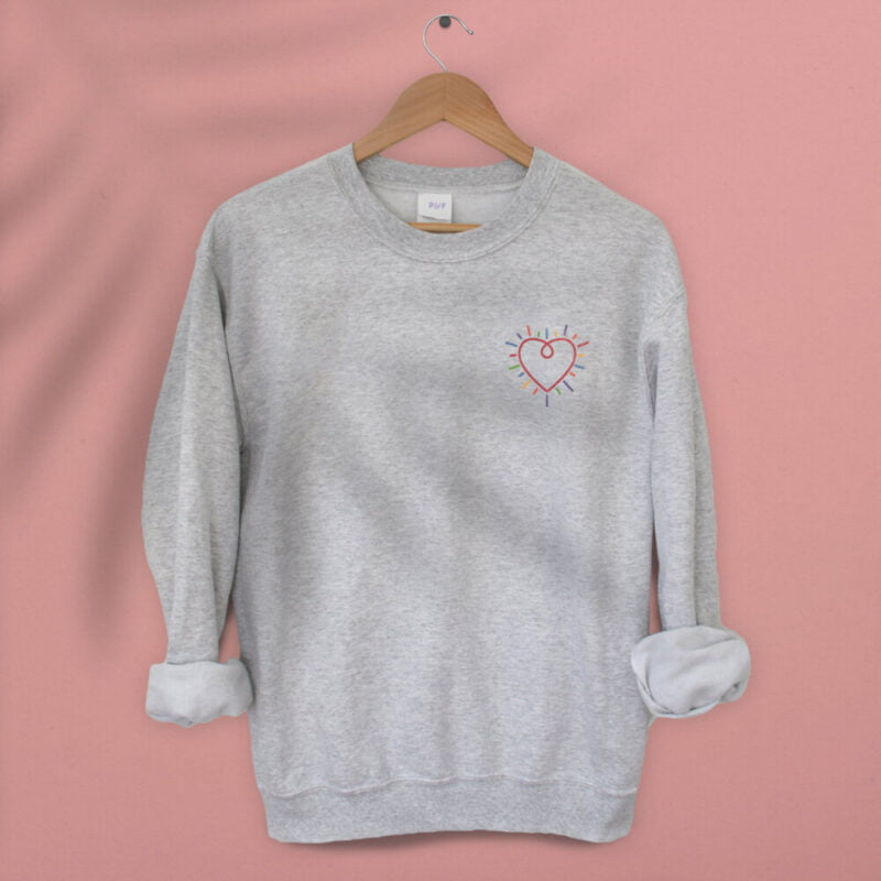 Show how colored is your heart. This sweatshirt has a heart-shaped embroidery in the colors of the rainbow in the chest. Sweats - LGBTQ+ Gay Pride Apparel - heart relaxsweat 1