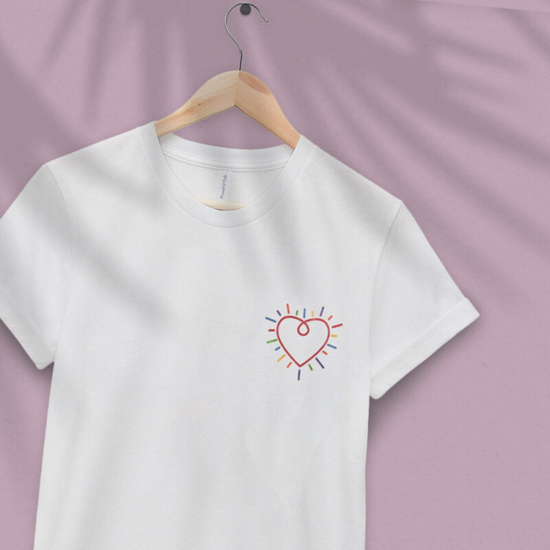 T-shirt with a big heart embroidered in the chest. The heart is red and multicolored lines are all around the heart. T-shirts - LGBTQ+ Gay Pride Apparel - heart tshirt 2