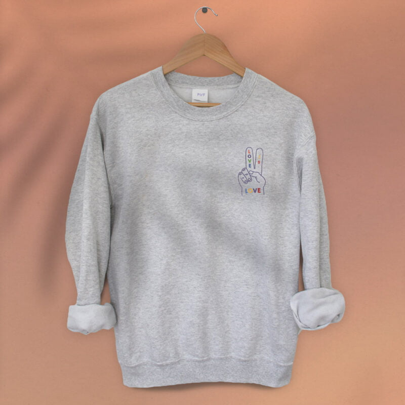 """Relax fit sweat with a disign on the left chest. A hand with the message """"Love is love"""" is embroidered with rainbow colors. Sweats - LGBTQ+ Gay Pride Apparel - loveislove relax 1"""