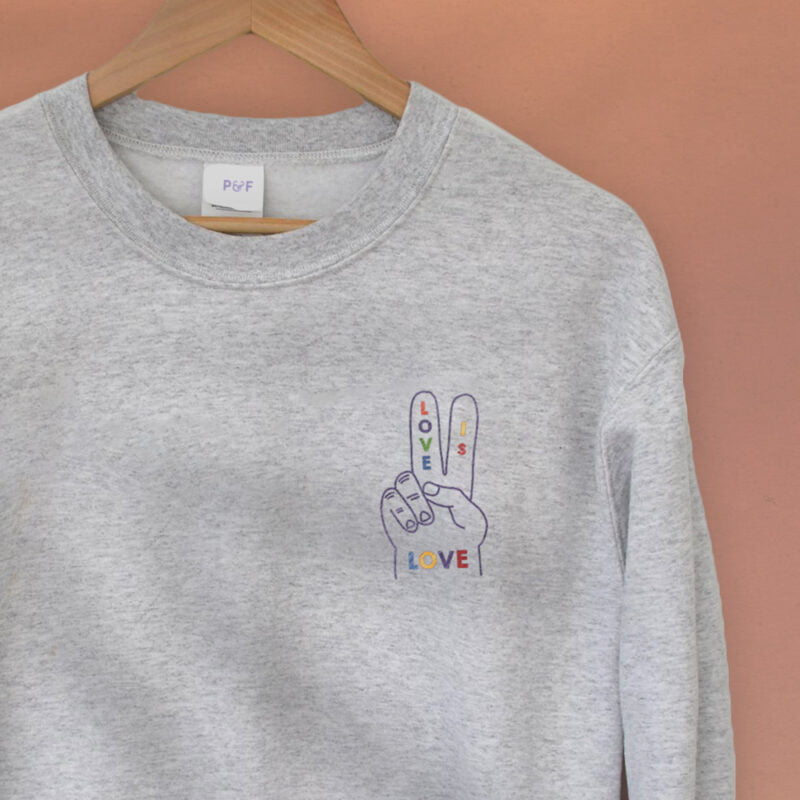 """Relax fit sweat with a disign on the left chest. A hand with the message """"Love is love"""" is embroidered with rainbow colors. Sweats - LGBTQ+ Gay Pride Apparel - loveislove relax 2"""