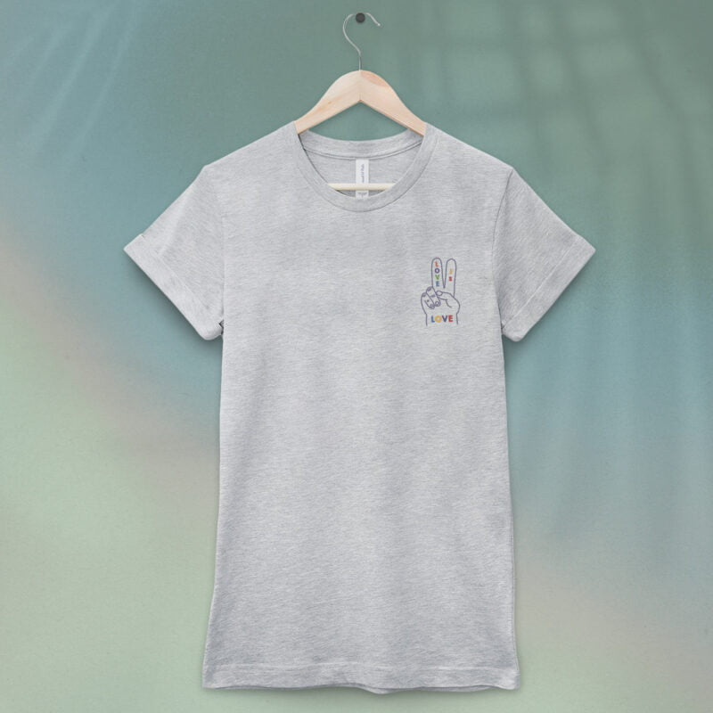 """T-shirt with a peace and love message embroidered on the left chest. This design shows a hand making the peace sign with """"Love is love"""" in rainbow colors. T-shirts - LGBTQ+ Gay Pride Apparel - loveislove tshirt 1"""