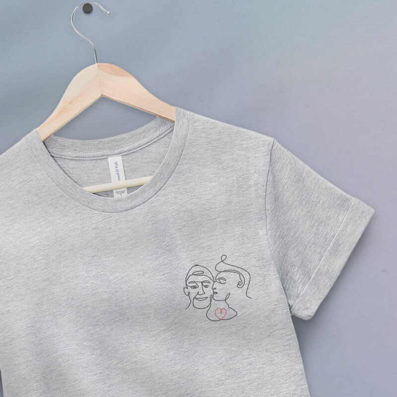 T-shirt with an embroidery showing 2 guys in love. The drawing is made from a single line. A colored heart connect the 2 lovers. T-shirts - LGBTQ+ Gay Pride Apparel - lovers color tshirt 2