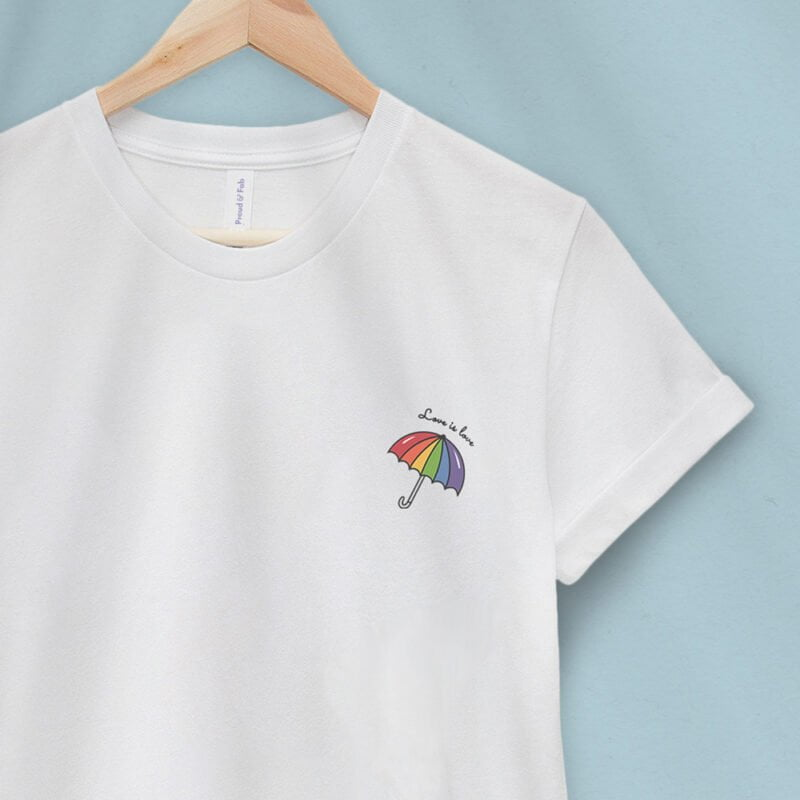 """T-shirt with a rainbow umbrella printed on the left chest. The sentence """"Love is love"""" is printed on the top of the umbrella. T-shirts - LGBTQ+ Gay Pride Apparel - umbrella loveislove 2"""