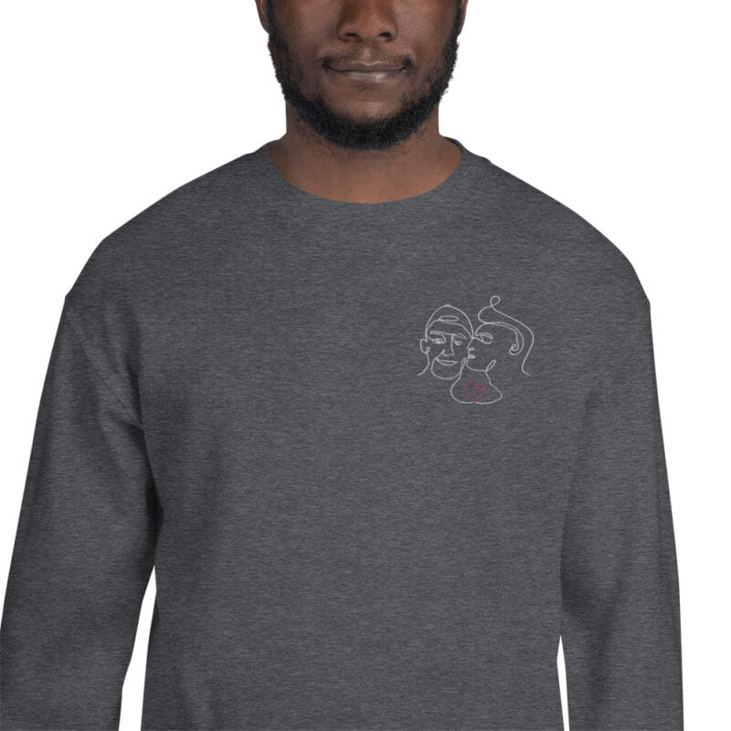 Relax fit sweat with an embroidery on the chest showing 2 lovers. One guy is kissing the cheek of the second man. Sweats - LGBTQ+ Gay Pride Apparel - unisex crew neck sweatshirt dark heather zoomed in 60a3aa64d2cff