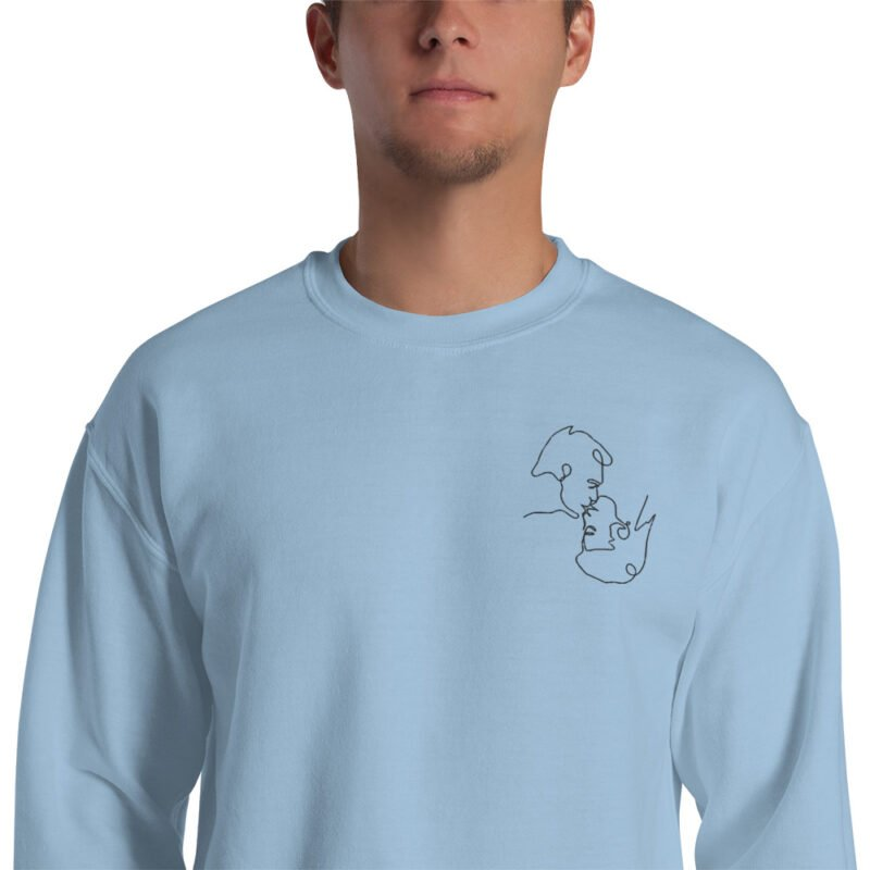 Relax fit sweat with an embroidery on the chest. The embroidery shows a gay couple kissing in a 69 style. The drawing is made from a single pencil line. Sweats - LGBTQ+ Gay Pride Apparel - unisex crew neck sweatshirt light blue zoomed in 60a3a06b3e156