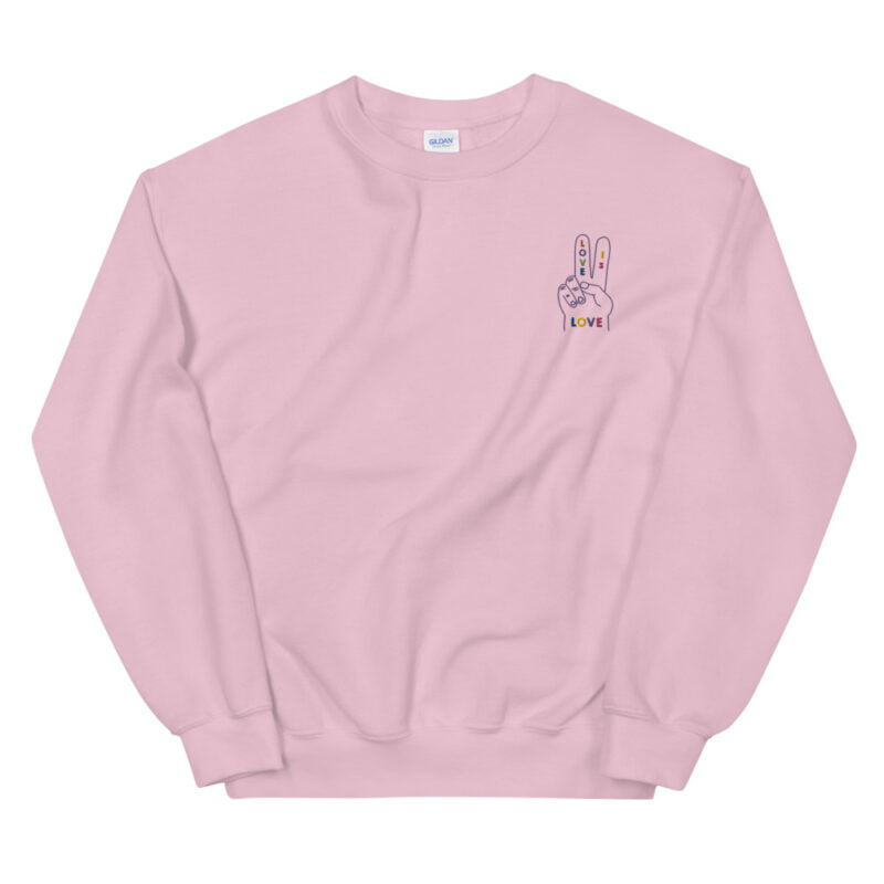 """Relax fit sweat with a disign on the left chest. A hand with the message """"Love is love"""" is embroidered with rainbow colors. Sweats - LGBTQ+ Gay Pride Apparel - unisex crew neck sweatshirt light pink front 60a2ab5245e74"""