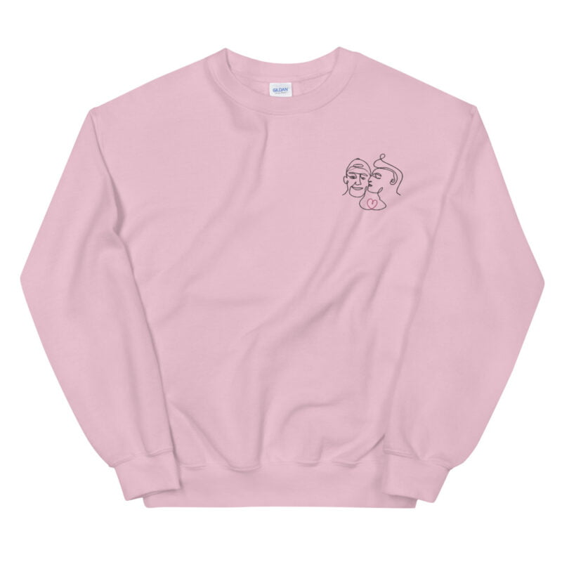 Relax fit sweat with an embroidery on the chest showing 2 lovers. One guy is kissing the cheek of the second man. Sweats - LGBTQ+ Gay Pride Apparel - unisex crew neck sweatshirt light pink front 60a3a0c616deb