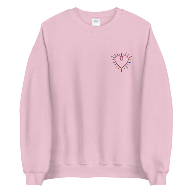Show how colored is your heart. This sweatshirt has a heart-shaped embroidery in the colors of the rainbow in the chest. Sweats - LGBTQ+ Gay Pride Apparel - unisex crew neck sweatshirt light pink front 60b3b2b58e96f