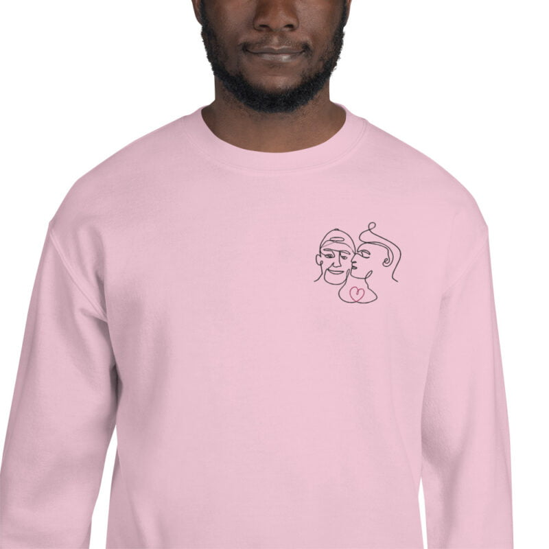 Relax fit sweat with an embroidery on the chest showing 2 lovers. One guy is kissing the cheek of the second man. Sweats - LGBTQ+ Gay Pride Apparel - unisex crew neck sweatshirt light pink zoomed in 60a3a0c6145a4