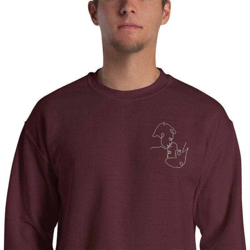 Relax fit sweat with an embroidery on the chest. The embroidery shows a gay couple kissing in a 69 style. The drawing is made from a single pencil line. Sweats - LGBTQ+ Gay Pride Apparel - unisex crew neck sweatshirt maroon zoomed in 60a3aa1a134dd