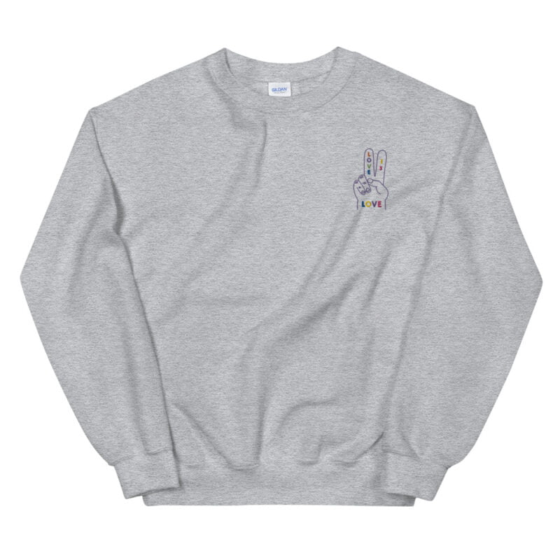 """Relax fit sweat with a disign on the left chest. A hand with the message """"Love is love"""" is embroidered with rainbow colors. Sweats - LGBTQ+ Gay Pride Apparel - unisex crew neck sweatshirt sport grey front 60a2ab5245882"""
