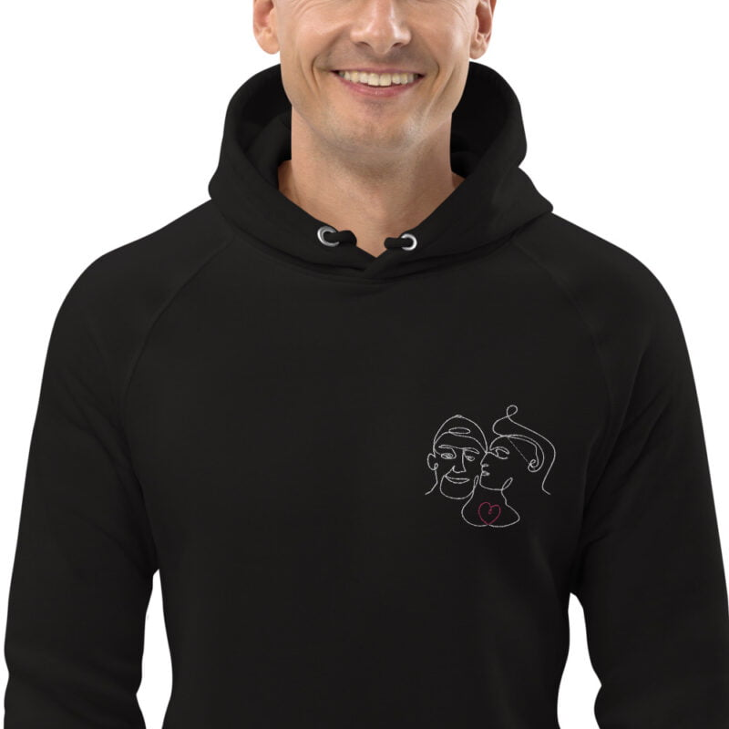 Hoodie with an embroidery of 2 men in love. One guy is kissing the cheek of the other one. The drawing represents 2 lovers with a single pencil stroke. A red heart connect the men. Hoodies - LGBTQ+ Gay Pride Apparel - unisex eco hoodie black zoomed in 60a3ab2fef462