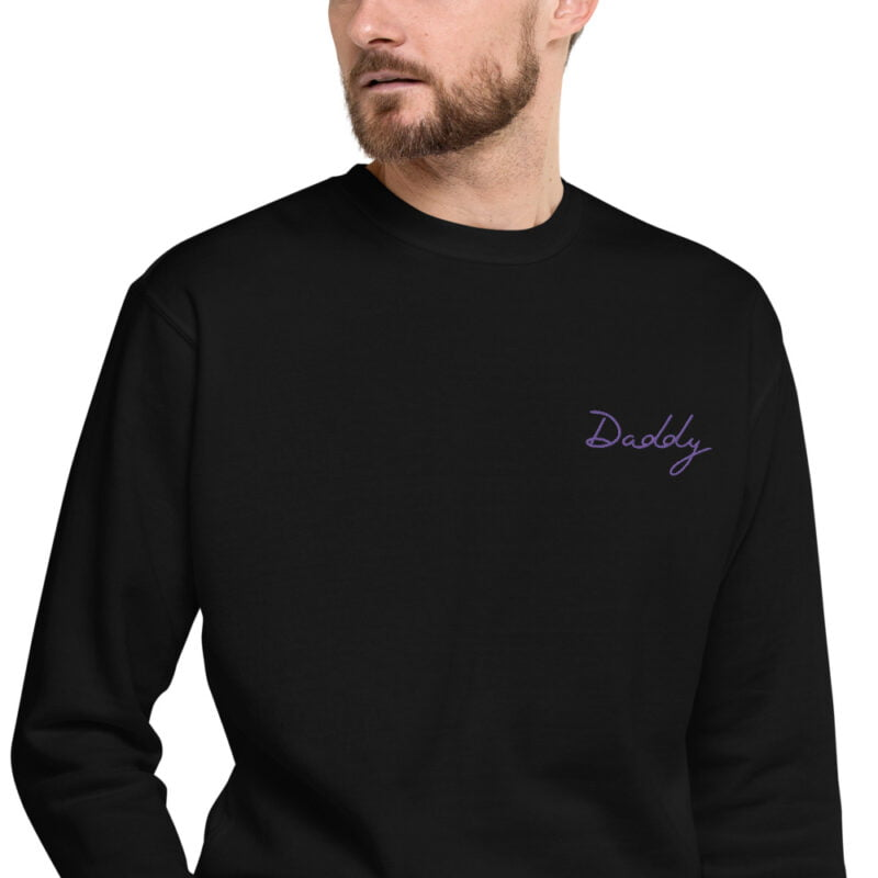 Regular fit sweat with embroidery on the chest. The word Daddy in handwritten in purple letters. Sweats - LGBTQ+ Gay Pride Apparel - unisex fleece pullover black zoomed in 60a38a01f11d2