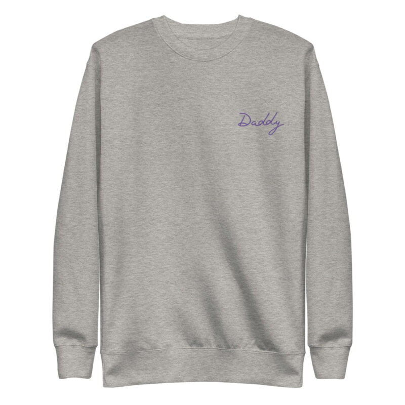 Regular fit sweat with embroidery on the chest. The word Daddy in handwritten in purple letters. Sweats - LGBTQ+ Gay Pride Apparel - unisex fleece pullover carbon grey front 60a38a01f0fd4
