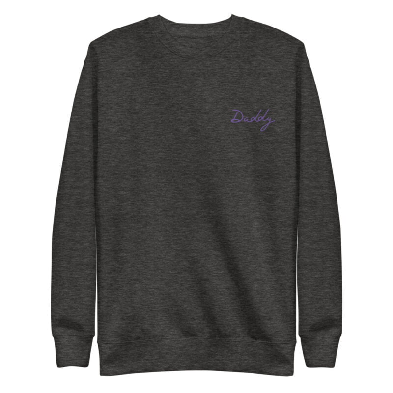 Regular fit sweat with embroidery on the chest. The word Daddy in handwritten in purple letters. Sweats - LGBTQ+ Gay Pride Apparel - unisex fleece pullover charcoal heather front 60a38a01f12f0