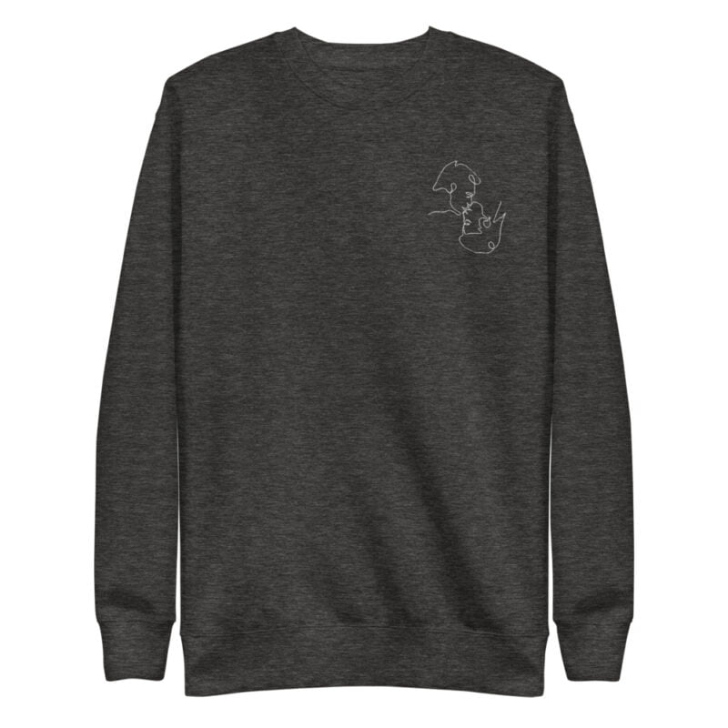 Regular fit sweat with an embroidery on the left chest. The embroidery shows 2 men doing a 69 kiss. The drawing is made from a single pencil line. Sweats - LGBTQ+ Gay Pride Apparel - unisex fleece pullover charcoal heather front 60a3aabed9da5