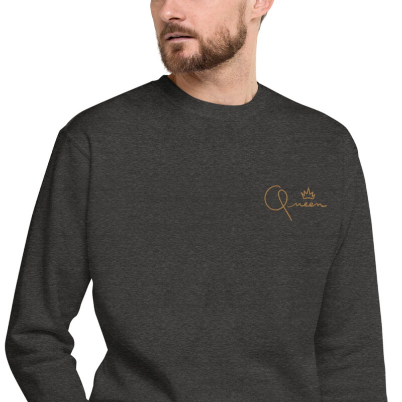 Regular fit sweat with the word Queen embroidered in the left chest. The embroidery is golden because true queens can only wear gold. Sweats - LGBTQ+ Gay Pride Apparel - unisex fleece pullover charcoal heather zoomed in 60af767beb601