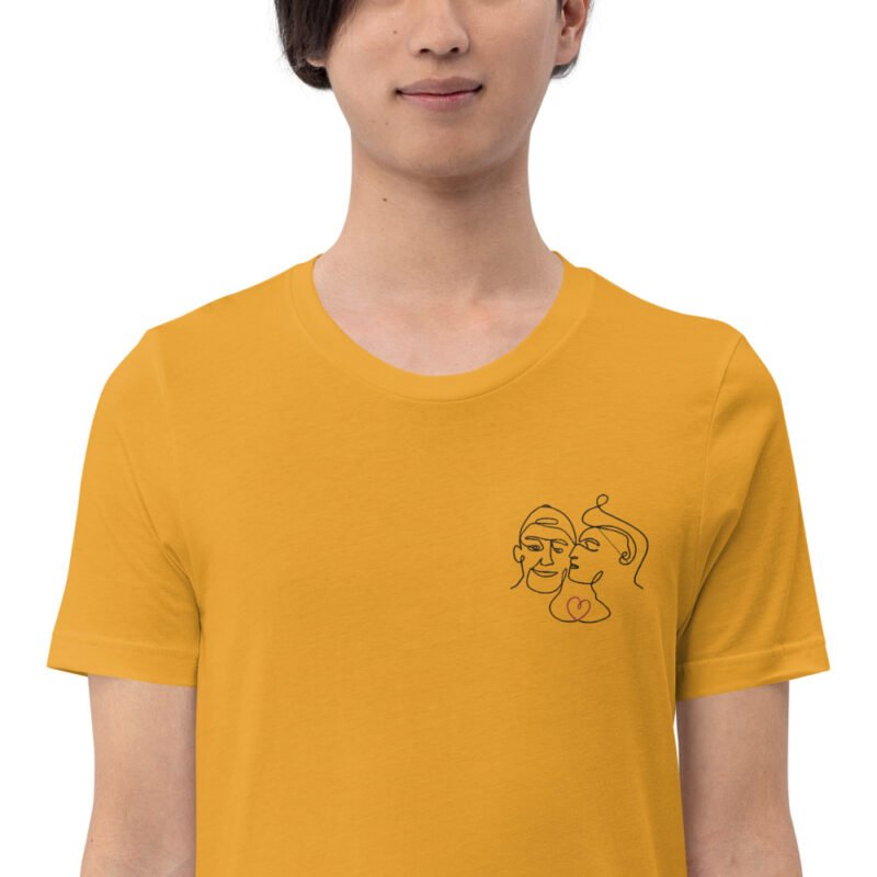 T-shirt with an embroidery showing 2 guys in love. The drawing is made from a single line. A colored heart connect the 2 lovers. T-shirts - LGBTQ+ Gay Pride Apparel - unisex premium t shirt mustard zoomed in 60a3a99f33f4e