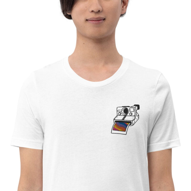 T-shirt with an embroidery on the left chest. This embroidery represents a vintage camera. A rainbow photo comes out of the Polaroid. T-shirts - LGBTQ+ Gay Pride Apparel - unisex premium t shirt white zoomed in 6097851b6d6af